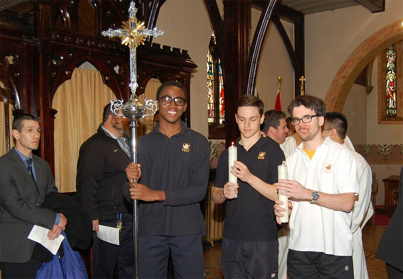 Cross-bearer and acolytes, from left to right: David Kondah, Ezra Campanelli and David Minnes, St. Mary.
