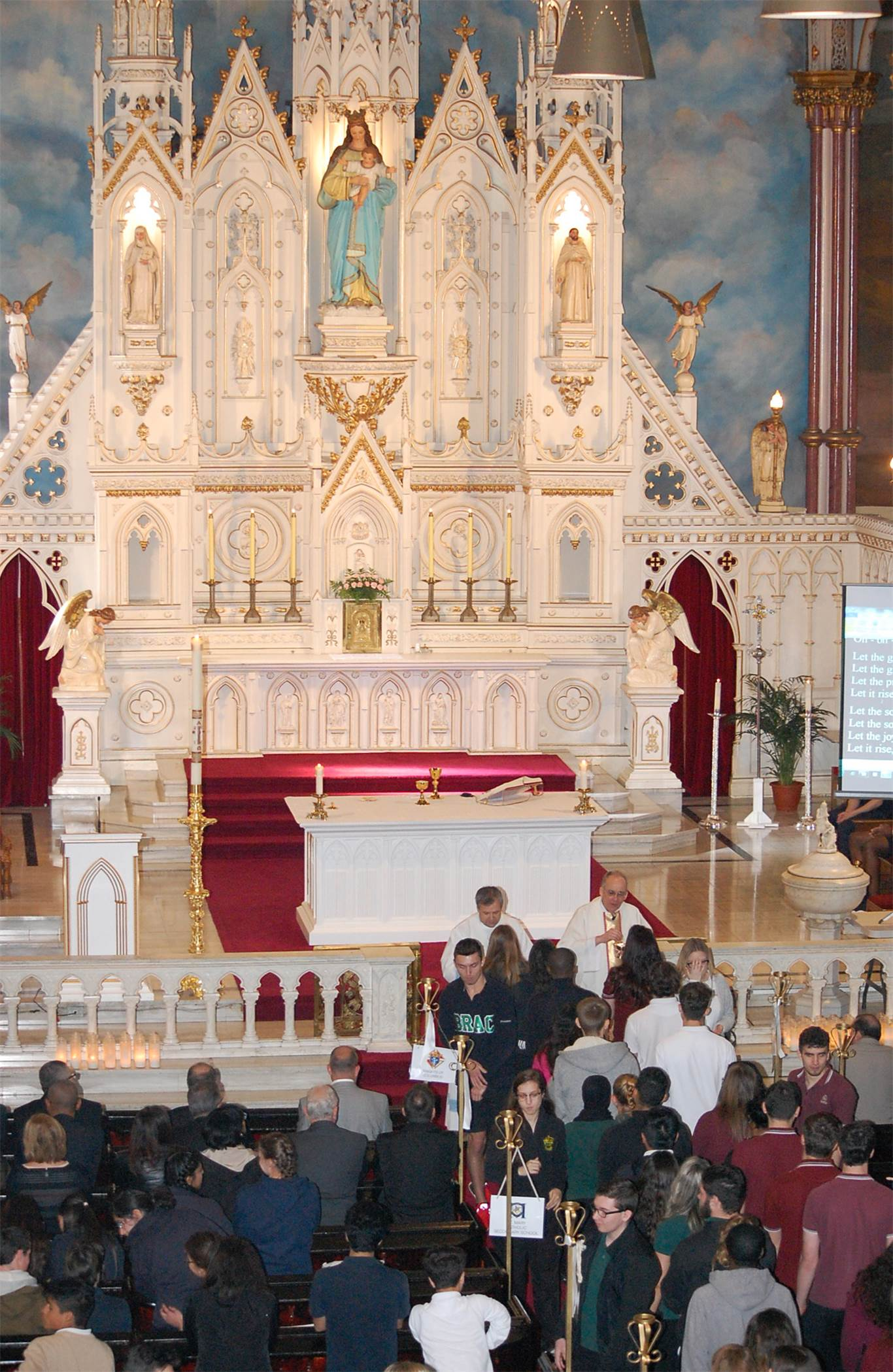 Graduating students give thanks for gift of Catholic Education at a system-wide mass at St. Mary Pro Cathedral on May 10th.