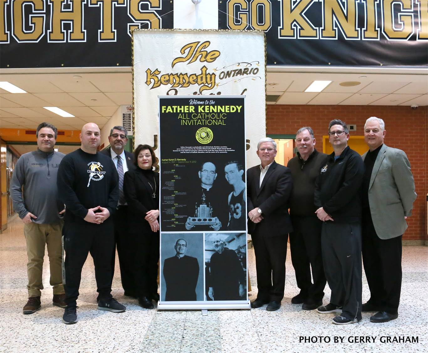From left to right: Luca Ciardullo, Tournament Convenor and designer of the Fr. Kennedy banner; Stefano Giovannageli, Convenor; Carm Barone, Principal of Bishop Tonnos; Sara Cannon, Principal of St. Thomas More; Patrick Daly, Board Chairperson; John Valvasori, Board Vice-Chairperson and Trustee for St. Thomas More; Chris D'Angela, Convenor; and Corrado Ciapanna, Superintendent for St. Thomas More. Photo by Gerry Graham.